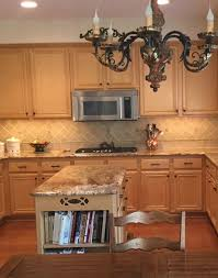 should i stain or paint my oak cabinets should i paint my oak cabinets or keep them stained