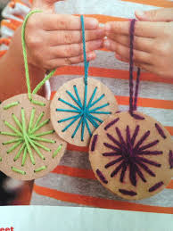 see sweet cut circles from cardboard punch holes with a thick