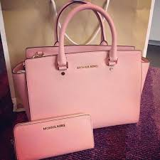 light pink michael kors handbag bigger michael kors store opens at albertville premium outlets just