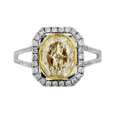 2 engagement rings 2 ct oval cut fancy yellow engagement ring 18k two tone gold
