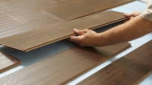 replacing laminate flooring imposing on floor throughout