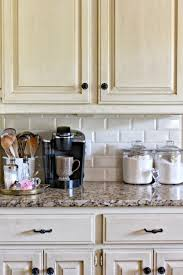 White Kitchen Backsplash Ideas by White Ceramic Subway Tile Kitchen Backsplash With Glass Accent