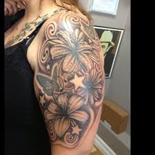 black ink lily flowers with flying butterflies tattoo on women