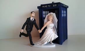 dr who wedding cake topper around the world and groom on globe with props