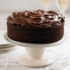 dark chocolate fudge cake woman and home