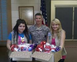 scouts help servicepeople with boxes of goodies news the