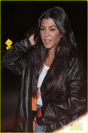 kourtney kardashian looks cool in a leather jacket at church