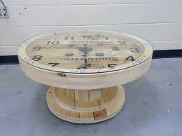 a cable wire spool made into a coffee table clock pallet tables