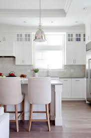 white kitchen wall display cabinets white cabinets with gray quartz counters transitional