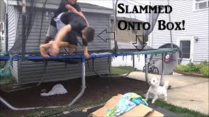 insane title match kid thrown of trampoline onto box backyard