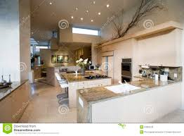 modern kitchen with stools at island in house stock image image