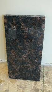 tan brown granite yeah or neigh