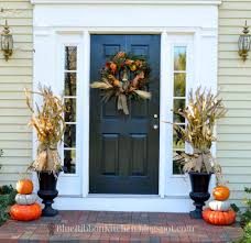 thanksgiving door ideas harvest front door stacked pumpkins and corn stalk urns corn