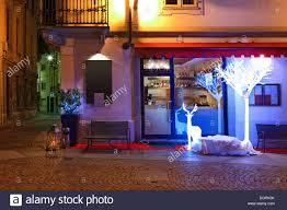 small restaurant on the corner with illuminated