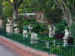there is a fake pet cemetery hidden behind the haunted mansion