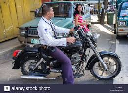 motorcycle philippines filipino policeman on a motorcycle in downtown manila philippines