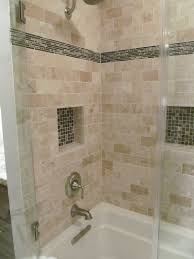 the shower surround is a travertine tile the accent tile was the
