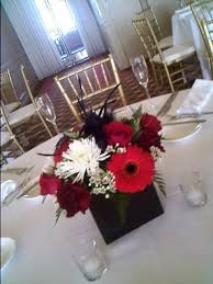 White Floral Arrangements Centerpieces by The Exotic Green Garden