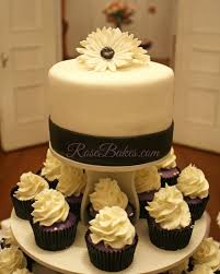 wedding cake and cupcakes behance