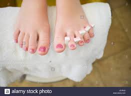 teenage receiving pedicure at a nail salon kaimuki oahu