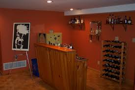cool orange accents wall paint of home basement bar designs idea