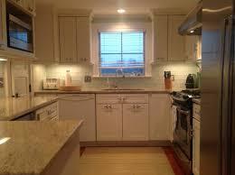 small u shape kitchen decoration using ivory white wood kitchen