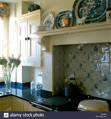 close up of blue white plates on shelf and blue white delft style