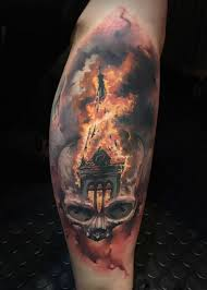 cool looking colored tattoo of human skull stylized with burning