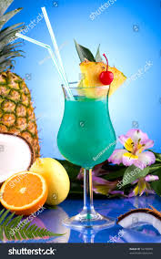 blue hawaiian cocktail blue hawaiian cocktail surrounded by tropical stock photo 16278049