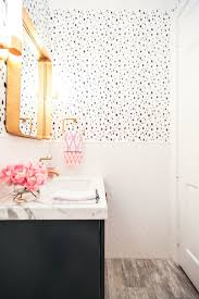 navy spotted bathroom in caitlin wilson wallpaper click through