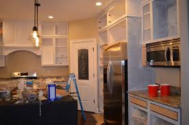 how paint your kitchen like the pro remington avenue remove any brush strokes and patches that need more attention one coat primer all frames sides sand away stokes let