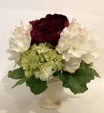 peony and hydrangea arrangement in ceamic vase burgundy and green