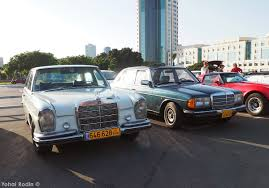 antique mercedes in motion classic mercedes benz w123 in heavy traffic