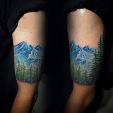 collection of 25 trees and blue wave tattoos on sleeve