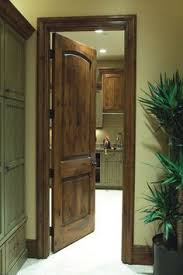 knotty alder doors and trim i like the shade of stain also