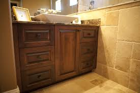 this master bathroom features alder vanity cabinets in a warm