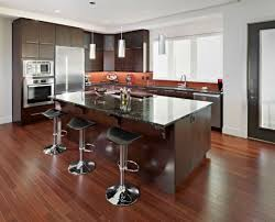 dark wood floors with light cabinets kitchen island with seating