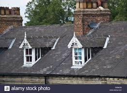 dormer windows on traditional terraced housing within the city