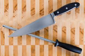 honing kitchen knives honing steel and french knife crossed stock photo image of grain
