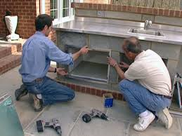 install doors and add finishing touches to an outdoor cabinet