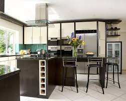imposing kitchen island table with wine rack and above fridge wine
