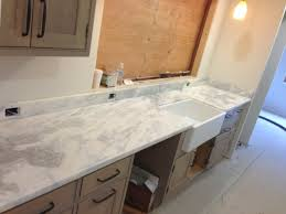 bathroom cozy quartzite countertops with lenova sinks and graff