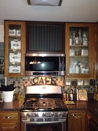 kitchen designed with glass doors cabinet with microwave range