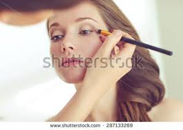 makeup professional makeup artist doing makeup beautiful girl stock photo 558062626