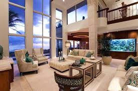 two story living room large square ottoman coffee table two story living room featuring