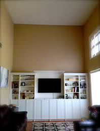 interior wall mounted tv with diy built in bookcase and cabinet