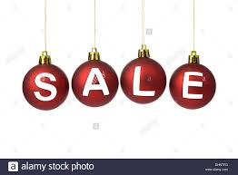 sale sign on baubles white background stock photo
