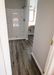 flooring in the bathroom and laundry room infarrantly creative