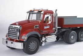 bruder fire truck buy bruder 02813 mack granite toy truck with flatbed trailer and