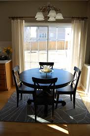 what size rug under dining table how to place a rug with a round dining table
